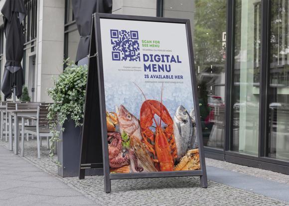 Menu před podnikem na reklamní tabuli